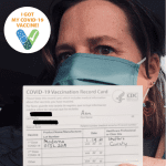 Woman with Covid Vaccination Record Card